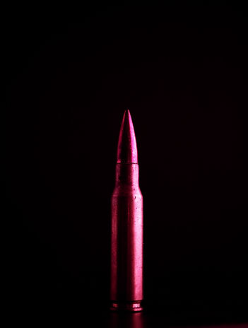 A vibrant, pink bullet pointing upward