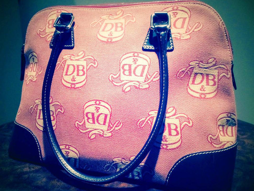 Dooney & Bourke Pink Crest Domed