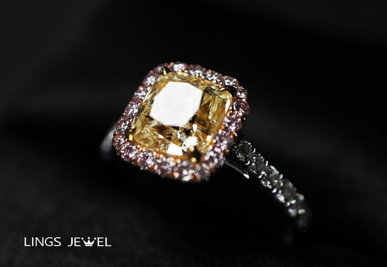 Yellow Diamond w pink diamond ring.jpg