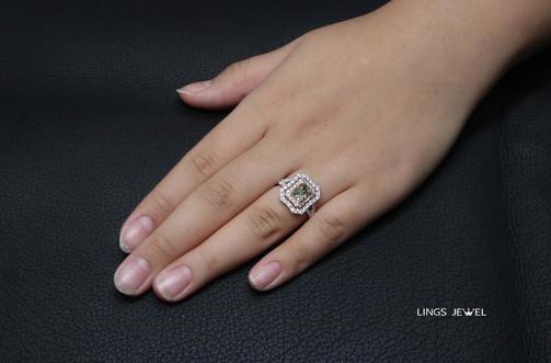1.1ct cushion Green diamond ring.jpg
