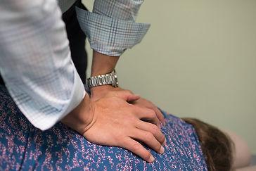 Dr. Gene Ross adjusting patient