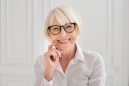 happy-woman-with-eyeglasses-medium-shot.