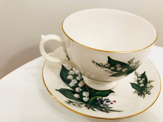 Queen Anne cup and saucer set: White and green floral