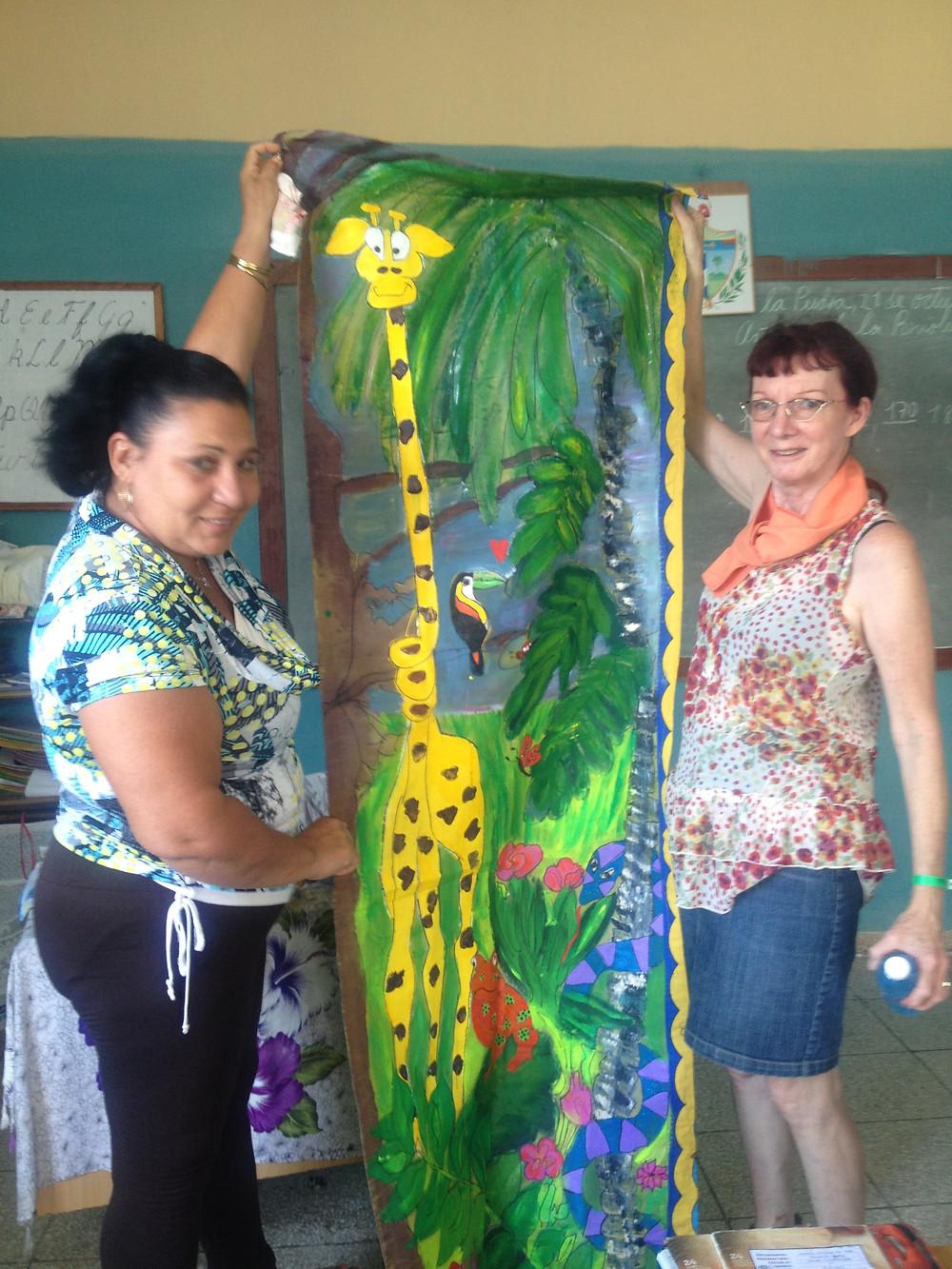 Doodlebug Donates a Wall Hanging at Cuban School