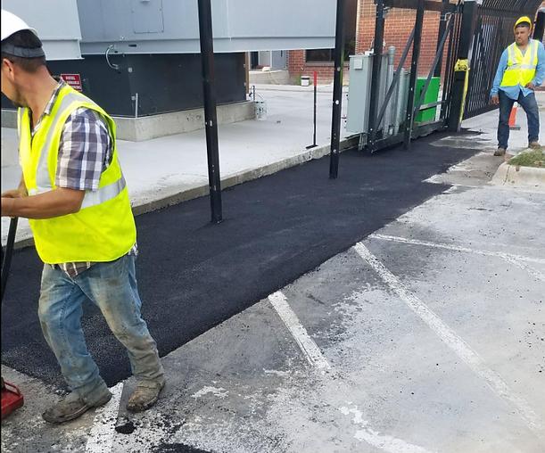 Compacting an asphalt patch in Austin, TX | Asphalt Contractors