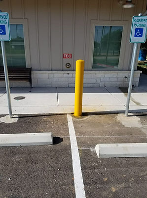 Wheel Stop, Parking lot sign, and bollard installatin