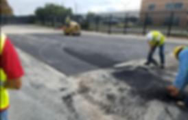 Compacting a large asphalt patch.PNG