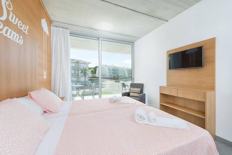 Twin bedrooms at the Majorcan Mojo base