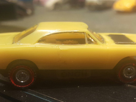 1968 Lemon Twist Yellow Dash Plymouth Roadrunner with Redline Tires.