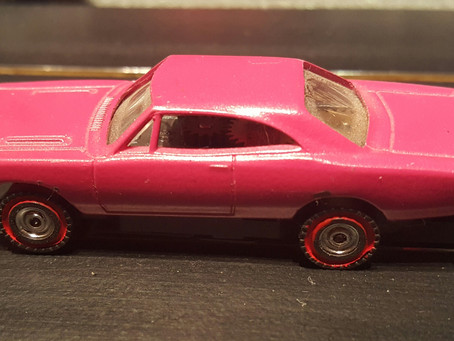 1968 Plum Crazy Purple Dash Plymouth Roadrunner with Redline Silicone Tires.