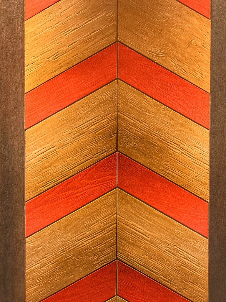 Close up of the wood pattern above the sinks in Norway Pavilion restrooms