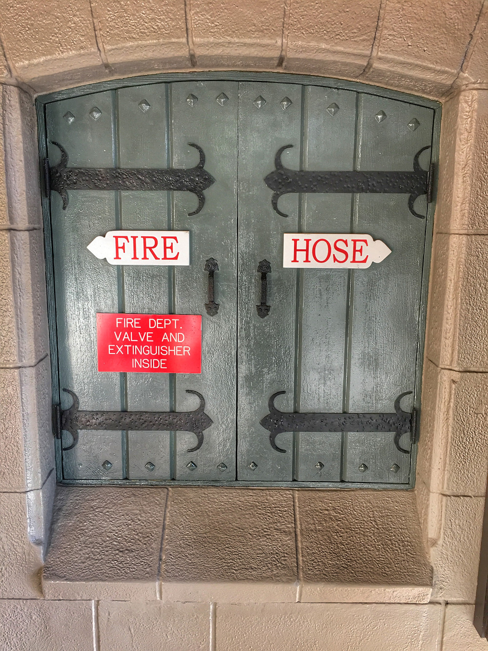 Fire Hose at Cheshire Cafe Restroom