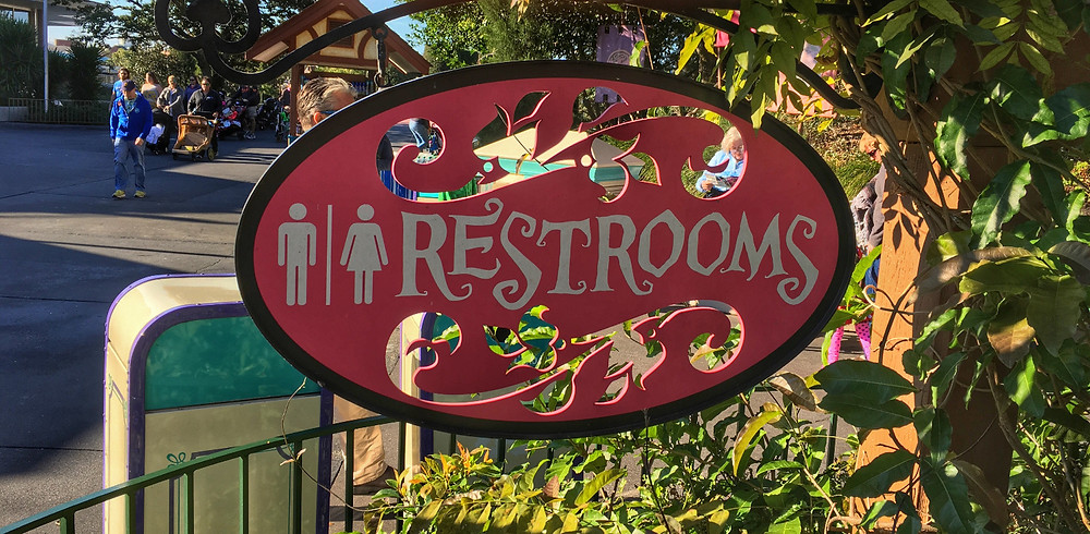 Restroom Sign at Cheshire Cafe Magic Kingdom