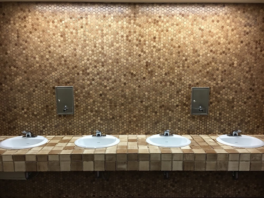 Tile above the sinks