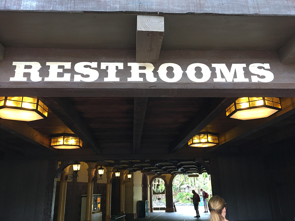 Restroom Sign for the Frontierland/Adventureland Breezeway