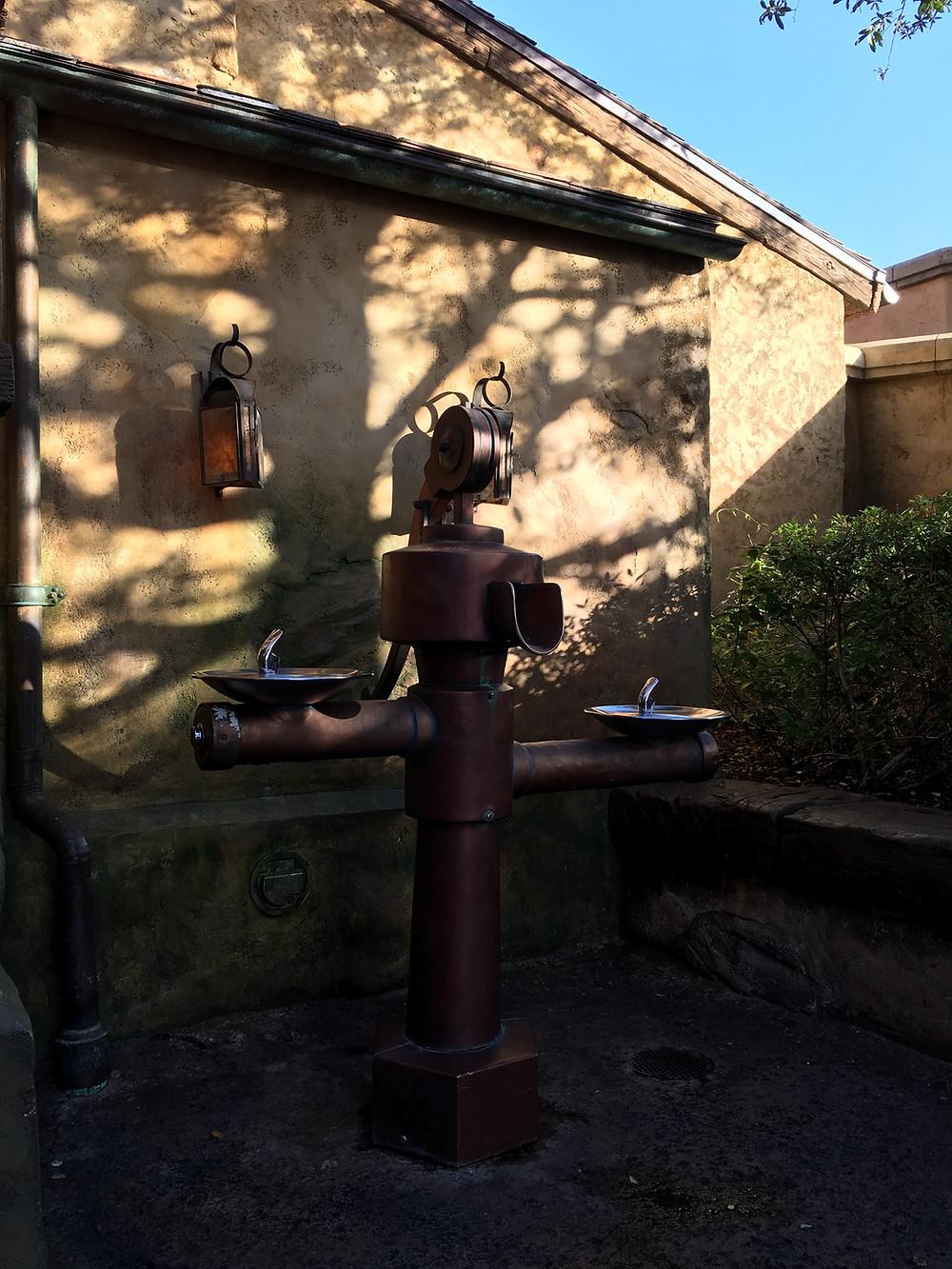 Water fountain/water pump outside Gaston's Tavern Loo, Magic Kingdom