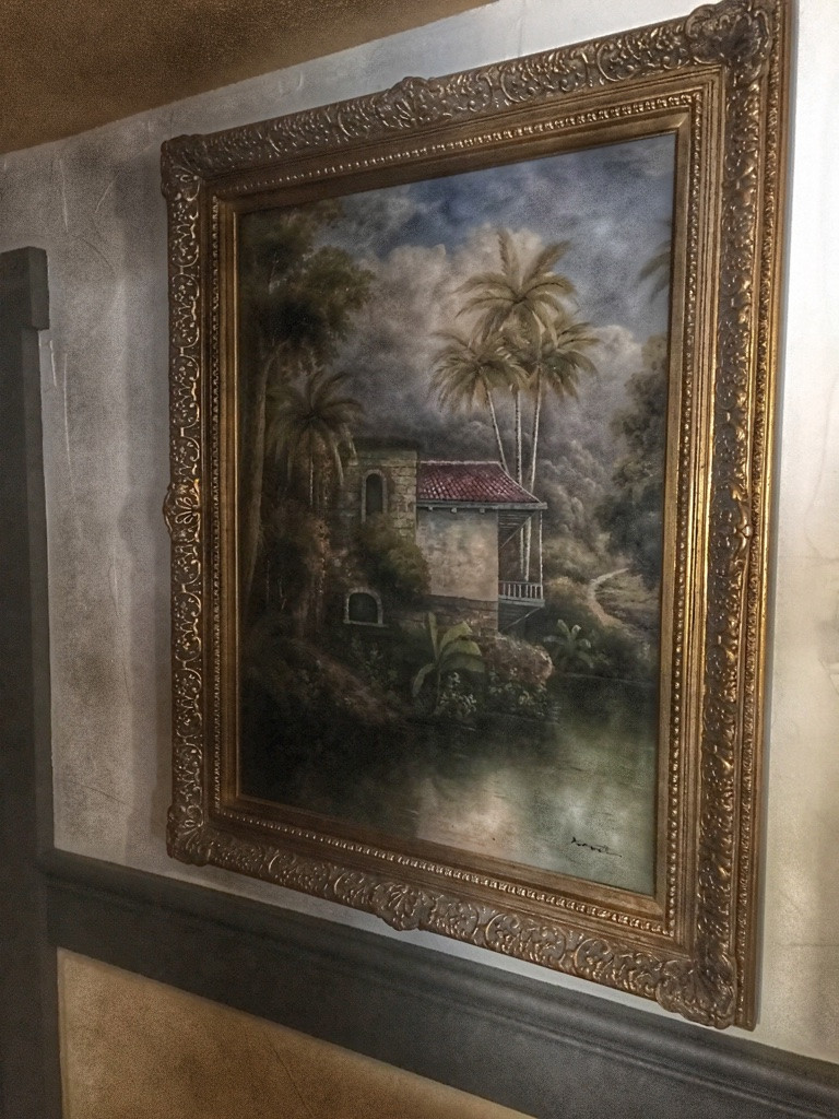 Wall Art Hanging Outside Restroom in Tortuga Tavern