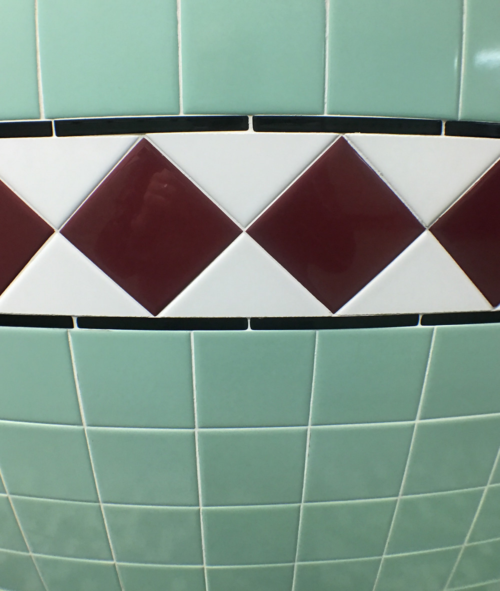 Tile pattern inside the men's room at 50's Prime Time Cafe