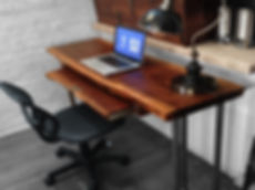 live edge waterfall desk made from natural wood slab and industrial pipe base..