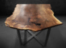 live edge wood slab table shown in walnut