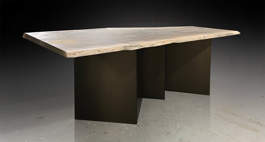 Live edge bar shown with oxidized sycamore on a bronze lighting base