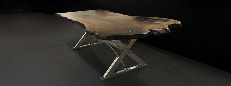 Live edge walnut table with stainless steel legs. Reclaimed wood.