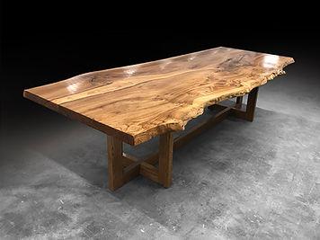 Natural tree slice table on a treslte base