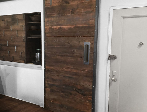 Reclaimed wood sliding barn door. Industrial steel.