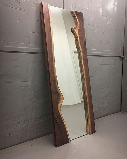 Live edge mirror shown with walnut wood slab