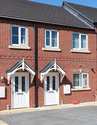 UPVC White Front Doors On Brick Terrace Houses
