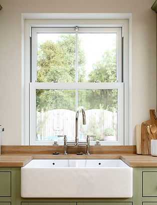 Vertical slider window behind a sink