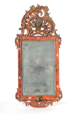 19th c. finely carved small red painted mirror with fruit motif