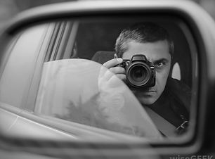 man-in-black-and-white-taking-photos-in-