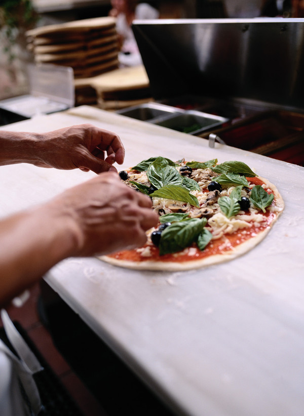 National Pizza with Everything (Except Anchovies) Day: Enjoy a loaded pie, oh my