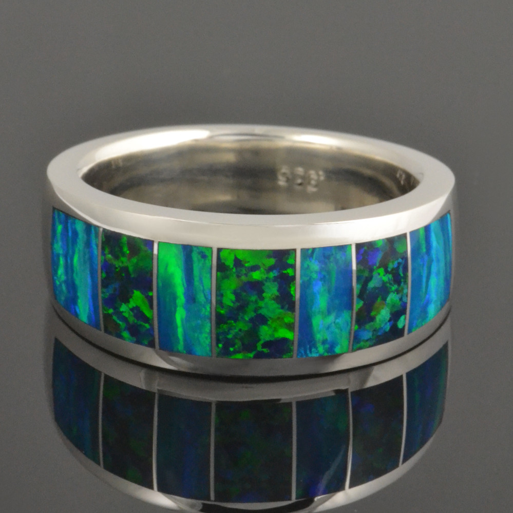 Lab created opal ring featuring lab opal inlay in 2 different colors.