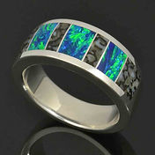 Lab created opal ring with dinosaur bone