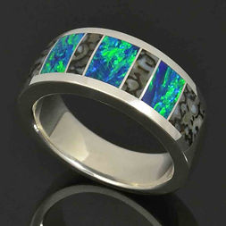 Lab created opal ring with dinosaur bone inlay