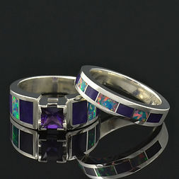 Lab created opal wedding ring with black diamonds