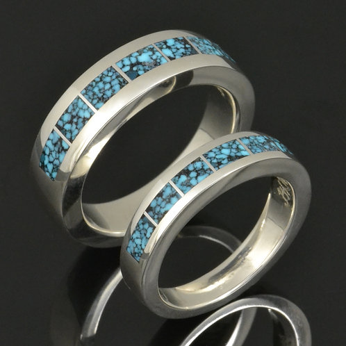Spiderweb turquoise wedding ring set in sterling silver by Hileman.