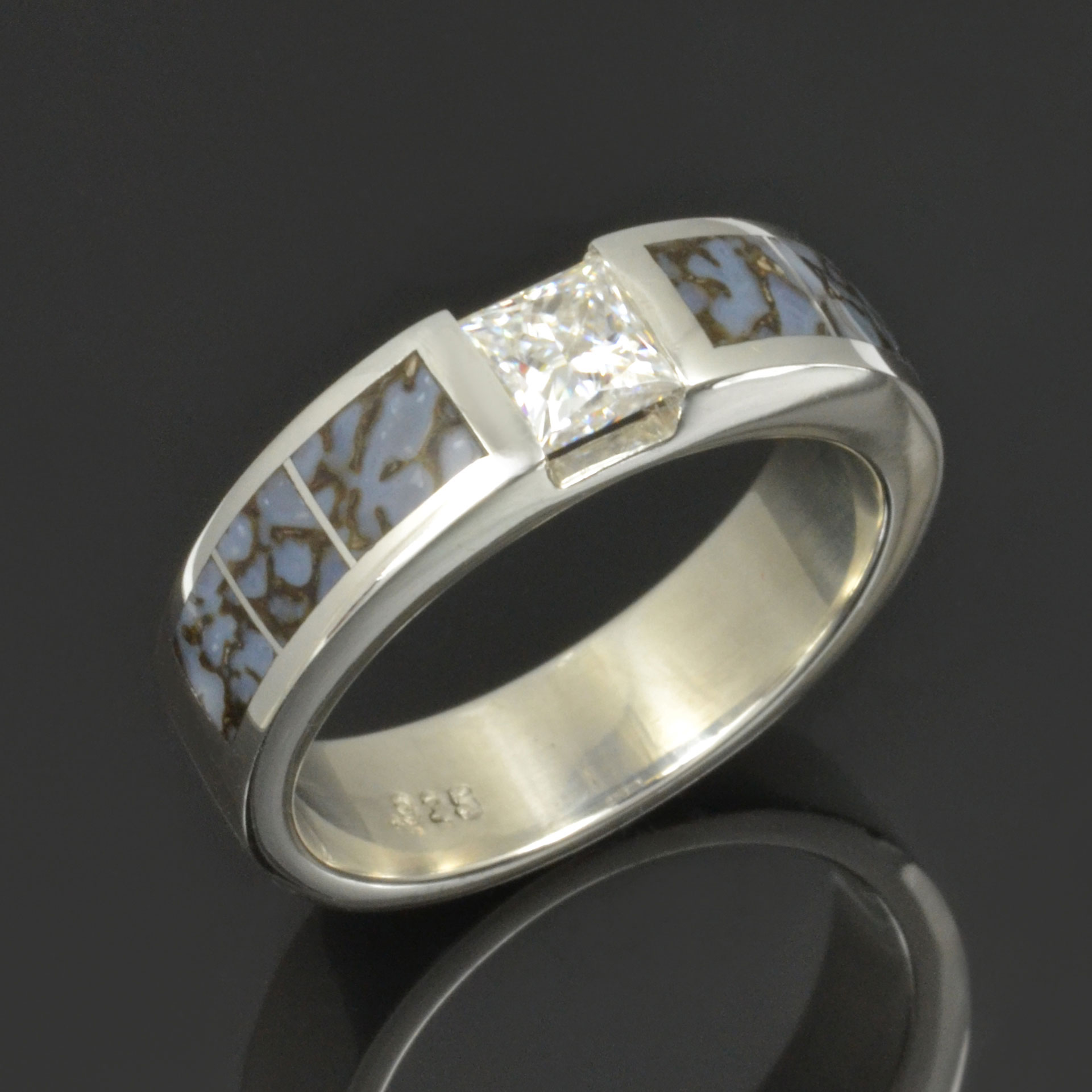 Blue dinosaur bone ring with moissanite set in sterling silver