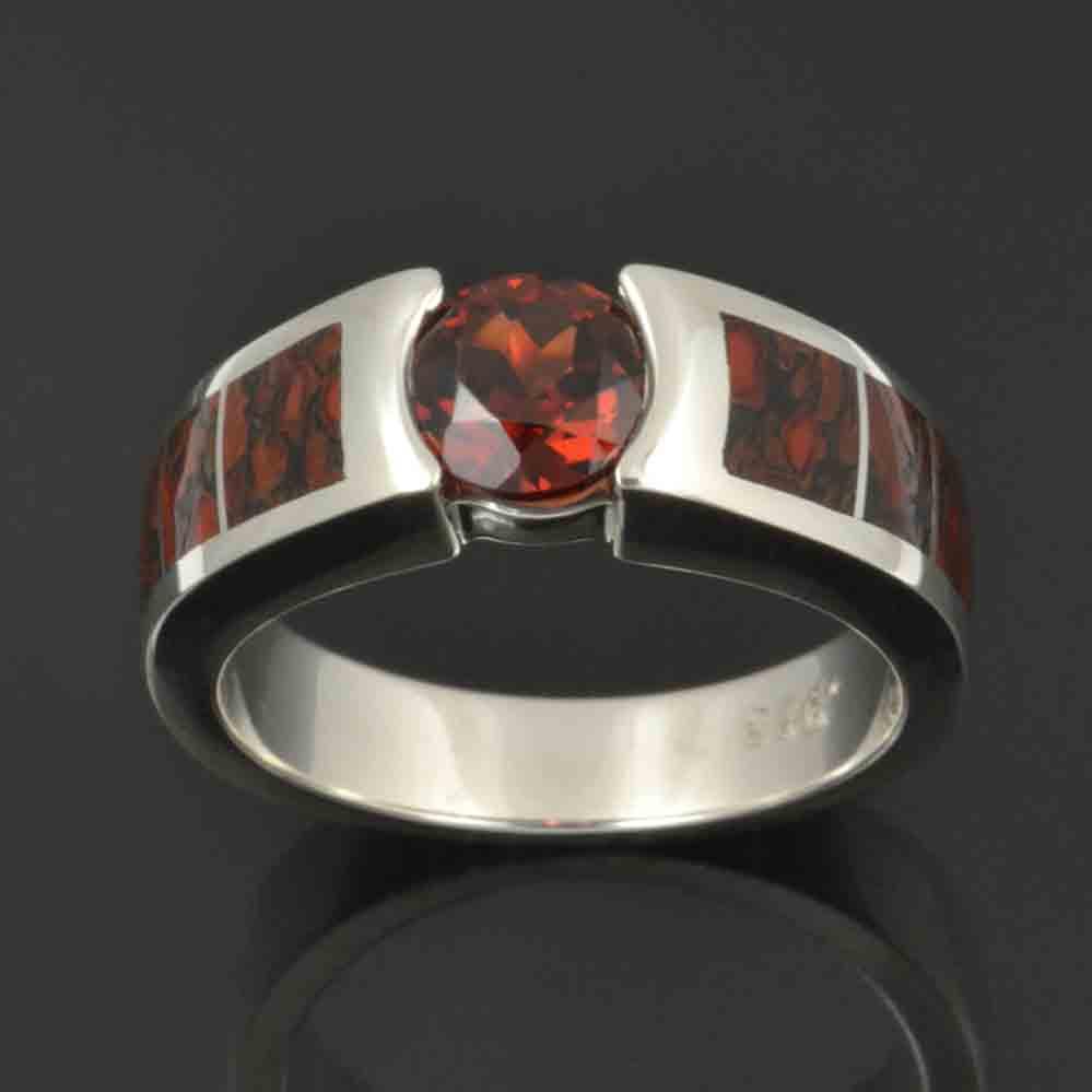 Dinosaur bone ring with red garnet in sterling silver.