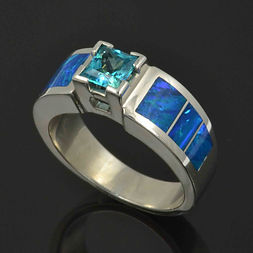 Lab opal engagement ring with blue topaz