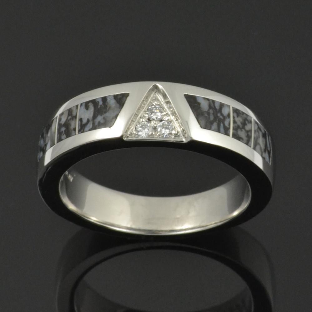 Dinosaur Bone Ring with gray bone and diamond accents set in platinum.