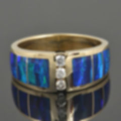 Lab created opal ring repair