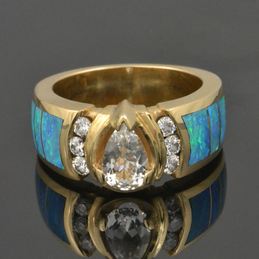 Australian opal engagement or wedding ring with white sapphire center and diamond accents in 14k gold.