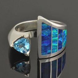 Lab opal wedding ring with blue topaz