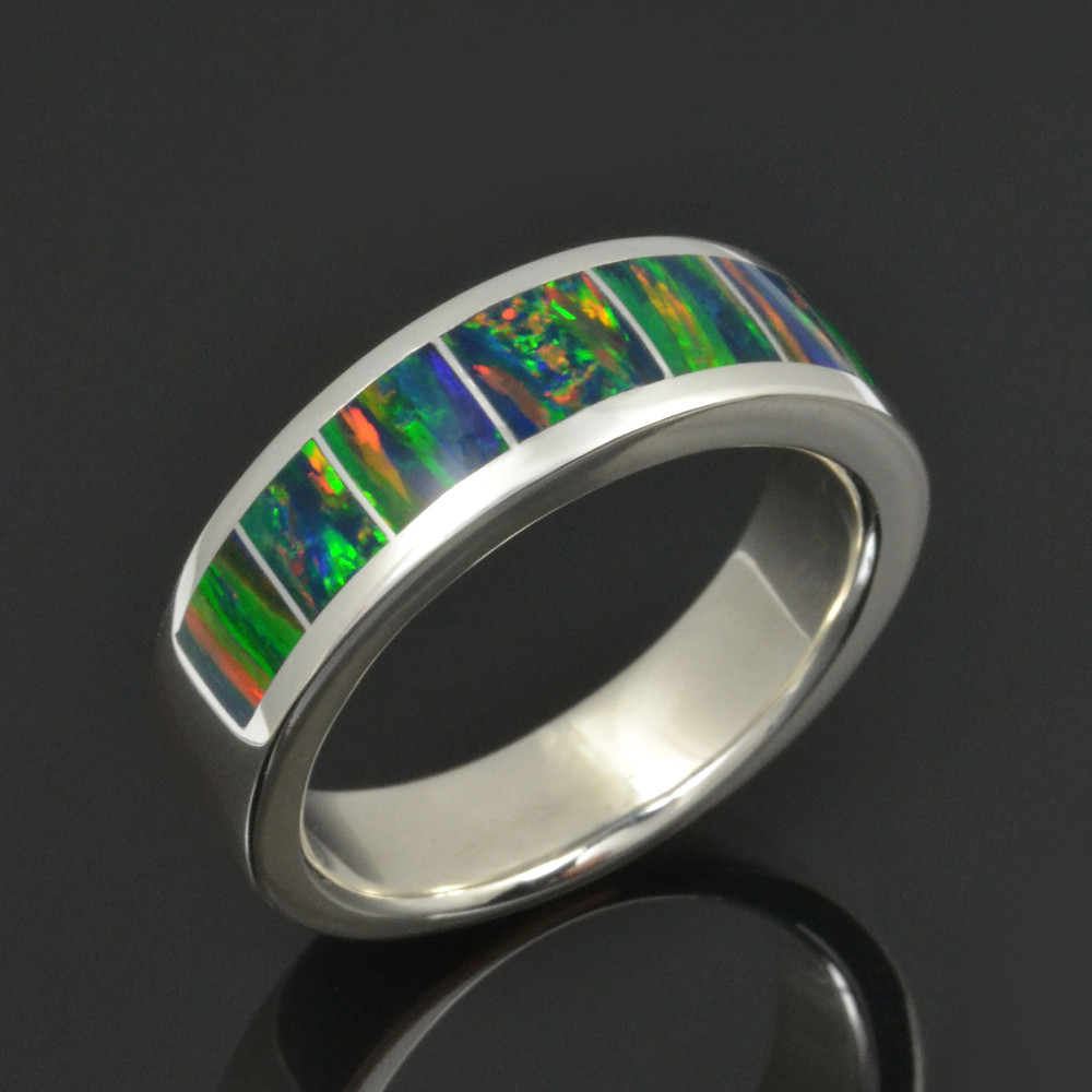 Man's lab opal ring featuring lab created black opal inlaid in sterling silver.