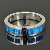 Lab opal wedding ring with blue sapphires