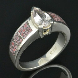 Pink dinosaur bone engagement ring with white sapphire in sterling silver