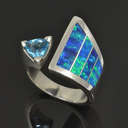 Lab opal and blue topaz ring